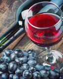 Glass of red wine with bottle Royalty Free Stock Images