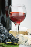 Glass of red wine with bottle Royalty Free Stock Photos