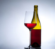 Glass of red wine and a bottle Stock Photo