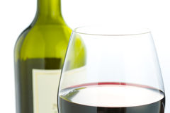 Glass and red wine bottle Royalty Free Stock Images
