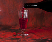 Glass of red wine and a bottle Royalty Free Stock Photos