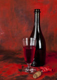 Glass of red wine and a bottle Stock Images