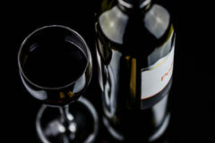 Glass of red wine and bottle Royalty Free Stock Images