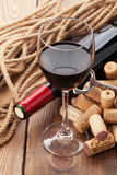 Glass of red wine, bottle and corks Royalty Free Stock Image