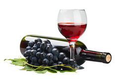 Glass of red wine with bottle and grape. Over white Royalty Free Stock Photos