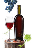 Glass of red wine, bottle and grape on stump isolated on white Royalty Free Stock Photography