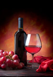 Glass of Red Wine and Bottle with Grapes. Red Wine and grapes, textured background stock images
