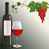 Glass of red wine with bottle and grapes on green Stock Images