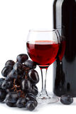 Glass of red wine, bottle and grapes isolated Royalty Free Stock Image