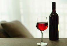 Glass of red wine and a bottle Royalty Free Stock Photography