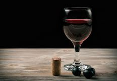 Glass of red wine and bottle of wine stock images