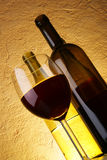 Glass of red wine and bottles Stock Photo