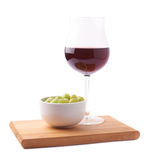 Glass of red wine and bowl of grapes Royalty Free Stock Images