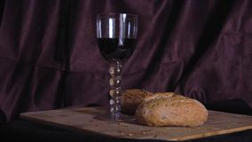 Glass of red wine and bread still life stock video footage