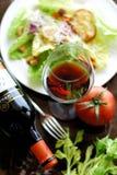 Glass of Red Wine  with Caesar Salad. Fresh caesar salad Stock Image