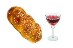 Glass of red wine and challah Stock Photos