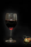 Glass of red wine and champagne's cork Stock Photography