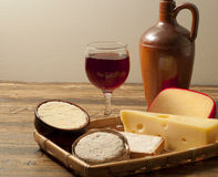 Glass of red wine and cheese Stock Images