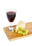 Glass of red wine, cheese, grape isolated on white Stock Photography
