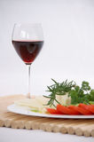 A glass of red wine with cheese, herbs and tomato Royalty Free Stock Photo