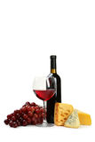 Glass of red wine, cheeses and grapes isolated on a white Stock Images