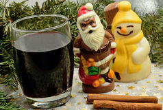 Glass with red wine and chocolate Santa Claus Royalty Free Stock Photography