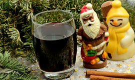 Glass with red wine and chocolate Santa Claus Stock Images