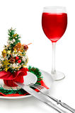 Glass of red wine and Christmas decoration. Stock Photo