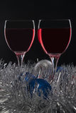 Glass of Red Wine and Christmas Ornaments Royalty Free Stock Image