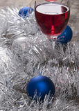 Glass of Red Wine and Christmas Ornaments Royalty Free Stock Photos
