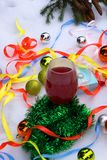 A glass of red wine and Christmas tree Royalty Free Stock Image