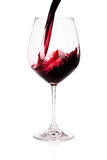 Glass of red wine closeup isolated on white Royalty Free Stock Images