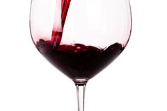 Glass of red wine closeup isolated on white Royalty Free Stock Photos