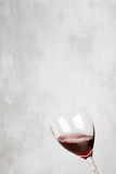 Glass of red wine with concrete background Stock Photo