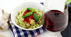 Glass of red wine with cooked pasta stock video footage