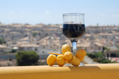 Glass of red wine and dates Royalty Free Stock Photo