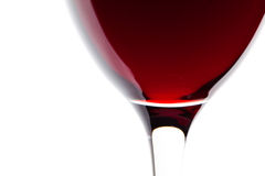A glass of red wine detail on white. Macro shooting with a glass of red wine on a white background. View from above stock photography