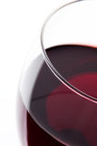 A glass of red wine. Detail on white. Macro shooting with a glass of red wine on a white background. View from above royalty free stock photography