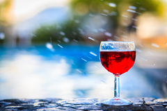 Glass of red wine. On the edge of the swimming pool Royalty Free Stock Photos