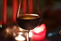 A glass of red wine. Enjoyed at dinner Stock Images
