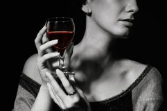 Glass with a red wine in a female hand royalty free stock photos