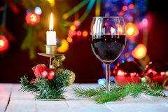 Glass of red wine for festivals of end of year Royalty Free Stock Image