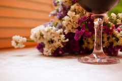 Glass of red wine and flowers Royalty Free Stock Photos