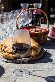 Glass of red wine with food on table Stock Photos