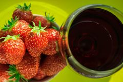 A glass of red wine and fresh strawberries Stock Photo