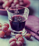 Glass of red wine and fresh grapes Royalty Free Stock Image