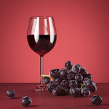 Glass of red wine and fresh grapes. 3d rendering Stock Photos