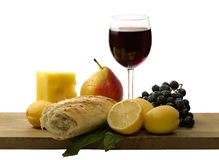 Glass of red wine and fruit Stock Images