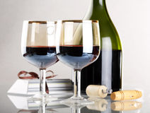 Glass of red wine with glass. And bottle Stock Photo
