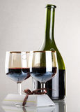 Glass of red wine with glass. And bottle Stock Photography